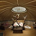 """<p>An 18-foot yurt situated in a clearing overlooking a fishing pond at lovely Crafty Camping in Dorset. Inside you'll find a seagrass floor, colorful wall hangings, a wood burner and a one-of-a-kind hand crafted wooden bed covered in a heavy duvet and blankets to keep things snug. Outside you've got your own deckchairs and hammock, plus a woodland dining table with logs for chairs, or, if you're feeling more social, head down to the woodland kitchen or sauna yurt. There's also an abundance of courses at Crafty Camping, you can even make your own chair! <br /><em></em></p><p><em>From £100 per night (sleeps 2),</em> <a href=""""http://www.canopyandstars.co.uk/coracle"""" target=""""_blank"""">canopyandstars.co.uk/coracle</a><em> </em></p>"""