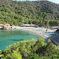 <p>My favourite beach on Ibiza, and probably the most bohemian on the island. Benirras is a gorgeous sheltered sandy cove on the North West coast not far from San Miguel. Loungers are still less than €10 for the day and if you stop by for sunset on a Thursday you'll be serenaded by bongo playing locals.</p>