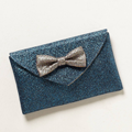 """<p>We're preparing to party in style and this adorbs glitter clutch bag will glam up any going-out look. We might even go crazy and take it to the office.</p><p>Bowtie shimmer clutch, £18, <a href=""""http://www.anthropologie.eu/anthro/product/newarrivals-accessories/7154469304438.jsp"""" target=""""_blank"""">anthropologie.eu</a></p><p><a href=""""http://www.cosmopolitan.co.uk/fashion/shopping/womens-clothing-under-ten-pounds"""" target=""""_blank"""">Shop daily fashion finds for £10 or less</a></p><p><a href=""""http://www.cosmopolitan.co.uk/fashion/shopping/investment-winter-coats"""" target=""""_blank"""">10 winter coats worth investing in</a></p><p><a href=""""http://www.cosmopolitan.co.uk/fashion/winter-fashion-trends-2013/"""" target=""""_blank"""">See the latest winter fashion trends 2013</a></p>"""