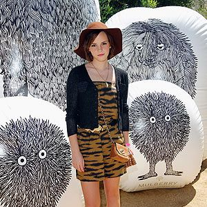 <p>Harry Potter cutie Emma Watson turned 22 at Coachella over the weekend... and what a way to celebrate! With multiple Mulberry parties and performances from the likes of Rihanna and Swedish House Mafia we reckon Coachella made a pretty good birthday party venue. Here she is working Mulberry's Fuzzy Tiger Playsuit teamed with cut-out gladiator sandlas and carrying the mini Lily with tassels. A fresh-faced beauty look and floppy 70s hat made for perfect festival fashion.</p>