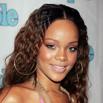 <p>Back in 2005 when Rihanna was a relatively unknown artist she chose a simple centre parting and nicely natural curls for her appearance at the Teen People Listening Lounge. Sweet, girly and not an ounce of attitude about it</p>