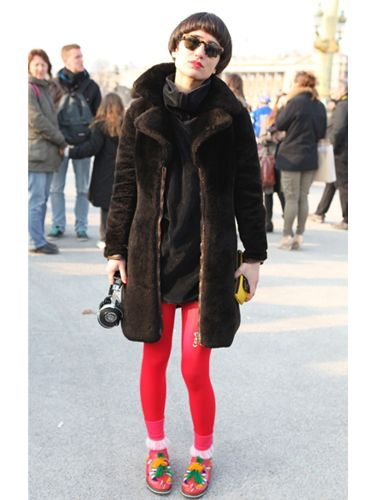 <p>Who wouldn't spot those neon tights? We love this sport luxe look, teaming brights with an oversized sweat and fur coat. Oh and not forgetting the matching pink lipstick</p>