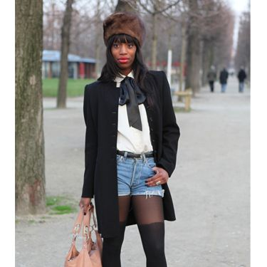 <p>Teaming ripped denim short-shorts with a pussy-bow tie shirt. This lady does smart casual to a tea. We love the fur hat and over-the-knee tights to update the look</p>