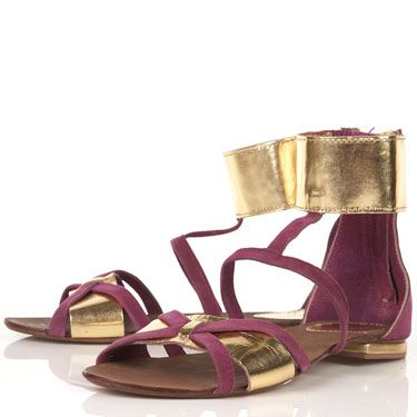 <p>With their metallic ankle cuffs, these Topshop sandals are seriously on trend. Wear with a neutral shift to rock that Roman look</p>