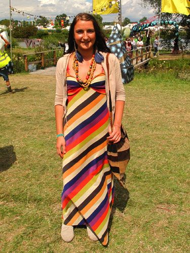 Working the maxidress at Secret Garden Party was Irene in this striped number by Apricot at New Look. We love her outsized feather earrings and wooden beads which originally belonged to her granny