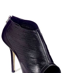 """<strong>2.</strong><br />""""OK, so I went over budget with them, but open-toe, laser cut shoes are on every fashion editor's wish list around the globe.""""<br /><br />Shoes, £345, Gil Carvalho<br />"""