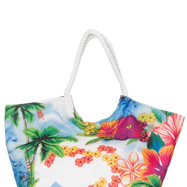 """<p>And this matching 'Island Paradise' beach bag would be a nice little addition to the swimmers. Don't mind if we do!</p> <p>£28, <a href=""""www.ripcurl.com""""target=""""_blank"""">ripcurl.com</a> or at 01637 850848</p>"""