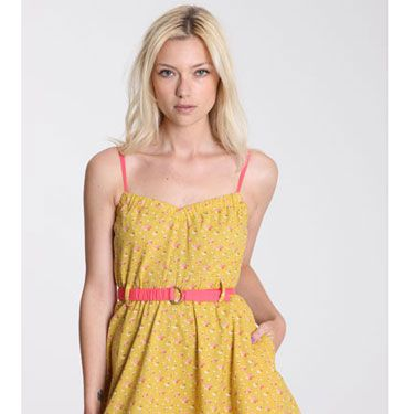 """<p>Get the 50s feeling in this yellow flared dress by Kimchi & Blue. We love the pink belt and straps, which adds a pop of colour. Wear your hair in a high ponytail and you're ready to get your flirt on!</p><p>Was £52&#x3B; now £20, <a href=""""http://www.urbanoutfitters.co.uk/kimchi-+amp-blue-ditsy-nora-dress/invt/5130424357784/&bklist=icat,5,shop,sale,salechristmasw,wsaledresses""""target=""""_blank"""">urbanoutfitters.co.uk</a></p>"""