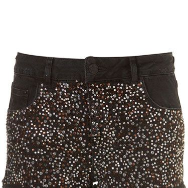 <p>Our mouth is watering looking at these sparkly studded hotpants. Rock with a printed tee, biker boots and a bold lippy</p>