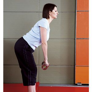 Holding a pair of weights, start with your legs straight but not locked at the knees. Bend forward from the hips, with your chest up and keeping your back straight. Lower towards the floor for a count of three before returning to the start position.<br />