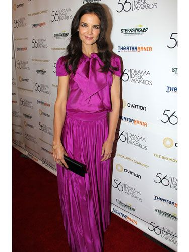 Katie Holmes manages to pull off fuchsia pink pleats without becoming an eyesore. How? Thanks to the fluid metallic silk material which flatters her frame giving her bags of confidence. Proof that looking like you're wearing the pleats, not the other way around, is half the battle...