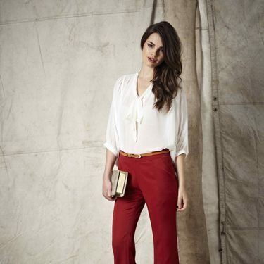 """<p>Rock the 70s look by teaming these amazing red flares with a pussybow blouse. Add a pair of killer heels to finish the look</p><p>Bobbie heels £30, Sinia top £18, Nila trousers £20 Kara bag £25</p><p><a href="""" http://www.boohoo.com/new-in/nila-flared-leg-stretch-trousers/invt/azz72829"""">boohoo.com</a></p>"""