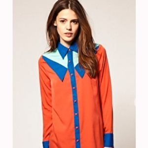 """<p>We love this shirt dress from ASOS, with contrasting orange and blue colours this will be hot for autumn winter!</p><p>£45, <a href="""" http://www.asos.com/ASOS/ASOS-Shirt-Dress-with-Double-Collar/Prod/pgeproduct.aspx?iid=1704296&cid=2623&sh=0&pge=1&pgesize=20&sort=-1&clr=Orange%2fblue """">asos.com</a></p>"""