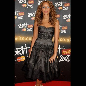 Leona Lewis looked beautiful in a charcoal strapless gown with metallic strappy sandals and smoking silver eyes.