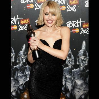Kylie looked stunning in a Stella McCartney strapless mini with hot pink nails.