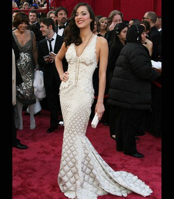 Best Actress Marion Cotillard competed for Best Dressed in this intricately detailed, mermaid-esque cream gown.