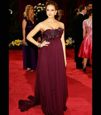 Gorgeous expectant mum Jessica Alba glowed in this trailing plum Marchesa gown, glammed-up with feathers around her front
