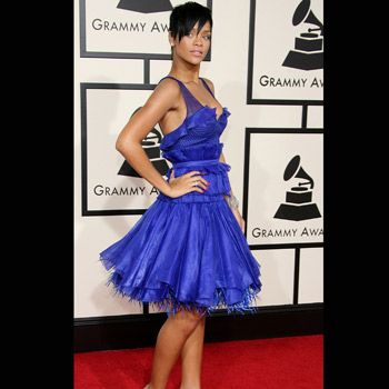 Rhianna looked striking in a cobalt blue, Zac Posen knee-length prom dress with elegantly styled cropped hair.
