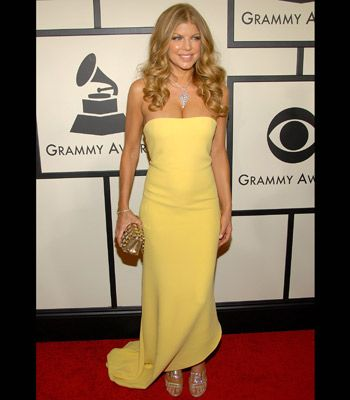 Fergie's minimalist yellow Calvin Klein dress complimented her glowing golden skin and goldy-locks.