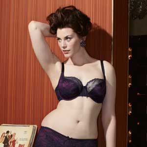 <p>A satin bra overlaid with delicate lace in a deliciously rich, autumnal shade of navy and plum – truly sumptuous.<br />