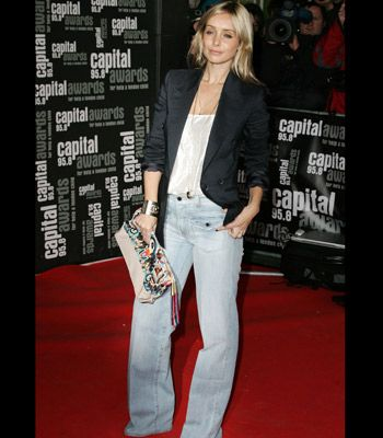 <p>Louise successfully teams pale denim wide legs with a sharp blazer for an up to the minute take on the trend.</p>