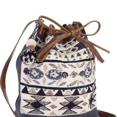 """<p>This knitted duffle bag is perfect for giving a nod to autumn/winter's hand-crafted Navajo trend.</p><br>£30,<a href=""""www.accessorize.com"""">Accessorize</a>"""