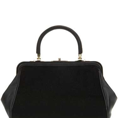"""<p>Pair this ladylike structured handbag with a printed tea dress and a smart wool coat for a touch of 40s-inspired glamour. </p><br>£45, <a href=""""www.topshop.com"""">Topshop</a>"""