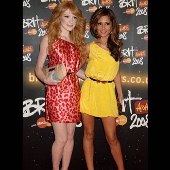 Cheryl Cole left her worries and wedding ring at home at this year's Brit Awards and joined band mate Nicola Roberts in wearing a one-strap mini. Their matching waist belts accentuated their tiny mid-drifts in these otherwise simple, but on-trend dresses.