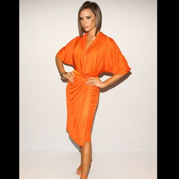 She often gets criticised by the fashion pack for being matchy-matchy but Posh's bright orange draped wrap-dress and paired stiletto sandals are bang on trend. We're not so sure about the coordinating tangerine tan though Vic…