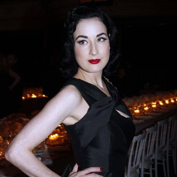 Dita proves red lipstick is vampy not trampy, playing it up against her pale skin.