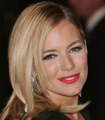 Sienna looked stunning at this years BAFTAs dressing up her black dress with a crimson Hollywood smile.