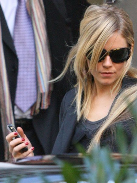<p>Sienna Miller developed a texting addiction, apparently sending Rhys 53 texts in one day</p>