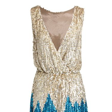 """<p>We can just see this dress in the Dancing on Ice wardrobe! If you fancy yourself a bit of a twinkle toes, get your hands on this little sparkler with a plunging neckline and gathered waist – there's a bit of a 70s twist to it too! </p>£150, <a href=""""http://www.asos.com/ASOS/ASOS-REVIVE-Sequin-Wrap-Front-Mini-Dress/Prod/pgeproduct.aspx?iid=1702918&SearchRedirect=true&SearchQuery=revive%20mini%20dress"""" target=""""_blank""""> asos.com</a> </p>"""