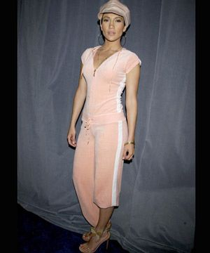 "J-Lo admits in Cosmo that she's ""the Queen of mistakes"". We're not sure if she was referring to her ill-fated romances, or this peach velour tracksuit and stiletto-sandals combo. We are sure, however, that trying to convince us she really <em>is</em> just Jenny 'from the block', <em>isn't</em> a good look."