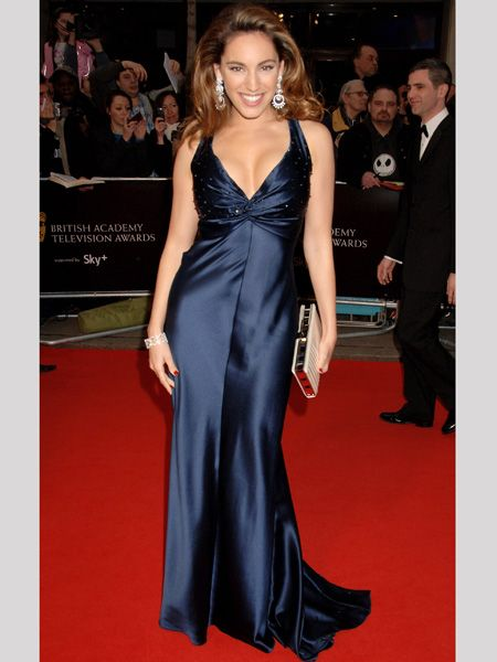 Red-carpet favourite Kelly unsurprisingly stole the show in this silk navy gown which oozed old school Hollywood glam  <br />