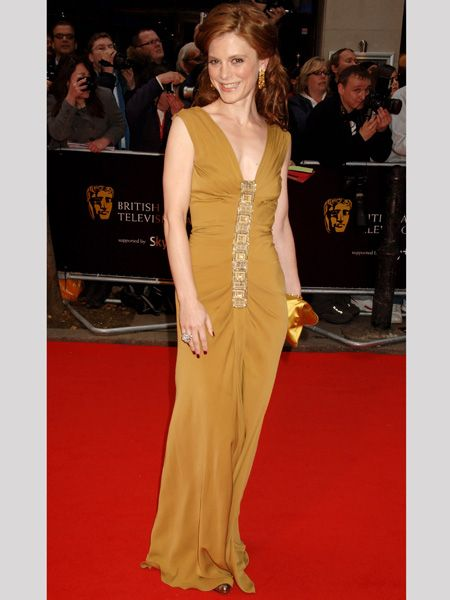 <p>Actress Emilia chose a winning mustard-gold Ferreti gown to perfectly off-set her wavy auburn hair</p>