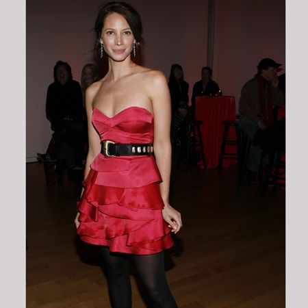 The lady in red looks lovely in this silky strapless number with layered ruffles  <br />