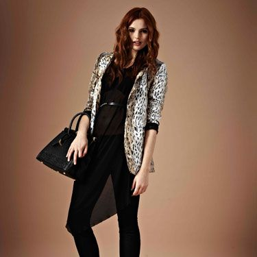 Who said animal print isn't office appropriate? We love this printed 3/4 length sleeved blazer. Team with a black silhouette and a pair of killer heels. Miaow, pussycat!