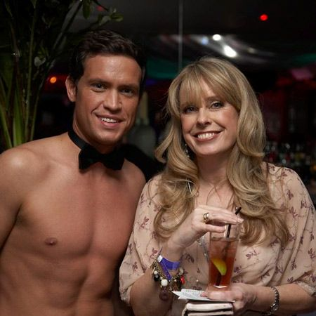 Cosmo's editor Louise Court enjoys a drink with a buff-bodied waiter. It's a hard job but someone's got to do it...  <br />