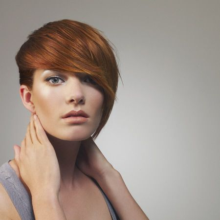 "<p>The face hugging fringe makes this neat little asymmetric bob style as does the rich golden coppery hue that's so high summer.</p><p> </p><p>Suzan Manning for Stafford Hairdressing, Belfast.  02890 662554 <a target=""_blank"" href=""http://www.pshb.com/"">www.pshb.com</a> </p><p> </p><p> </p>"