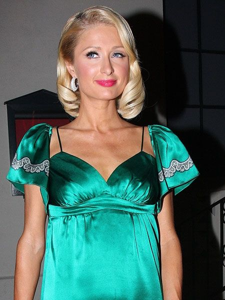 <p>Paris Hilton denies that she is pregnant after emerging from a restaurant with what looked like a baby bump. She probably just had diner, leave the poor girl alone</p>