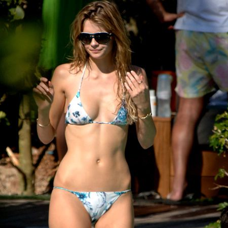 <p>Mischa doesn't let her shape stand in her way of being beach beautiful. We've got proportion fixing tricks and the best bikini buys to ensure your body looks utterly bootylicious.</p>        <p> <br />- Dark bottoms and bright tops will make you appear more in proportion<br />- Hide your problem area with a wrap around skirt and keep bikini bottoms plain<br />- Padded tops will make your chest appear bigger</p>    <br /><br />