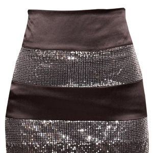 """<p>The perfect multi use skirt, team with a rock t-shirt for a funked-up look or pussy bow blouse for that ultra glam feel.</p> <p><a href=""""http://www.boohoo.com/restofworld/collections/sequins/icat/sequins/"""" target=""""_blank"""">boohoo.com</a></p>"""
