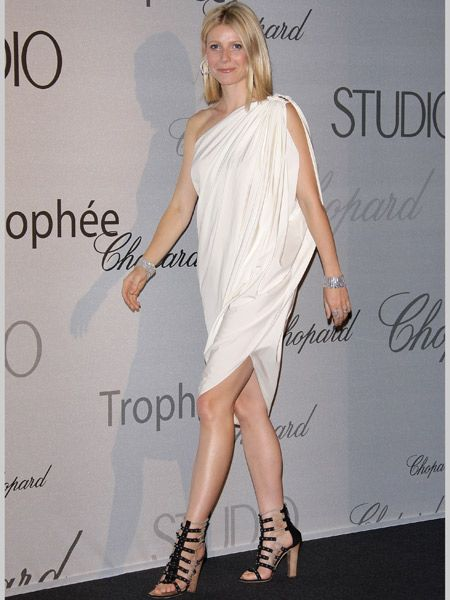 Gwyn found her fashion focus with her footwear at this year's Cannes Film Festival. She was the talk of the style world in this toga-style Lanvin dress with Romanesque sandals and those glam gold glads which redefined her LBD (previous picture)  <br />