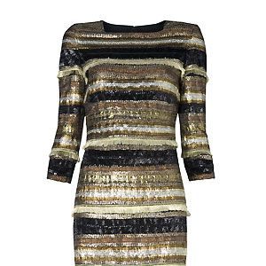 """Oh Mango, what are you doing to us here at Cosmo? We need to shop for other people, but we can't when you're luring us with a delightful frock like this one. With its liquid gold shades and subtle shimmer, we're in metallic heaven<p>£179, <a href=""""http://www.mango.com/"""">Mango</a></p>"""