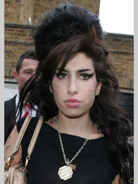 Amy's beehive and eyeliner horns have become symbols of modern rock chick. Her excessive hair on her miniscule frame accentuates her rebellious look granting her serious rock 'n' roll kudos.  <br />