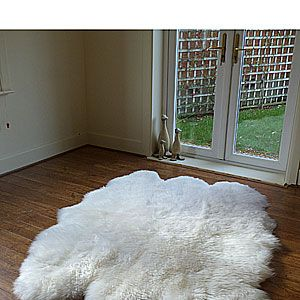 """<p>Steer clear of stuffed toys, and get him an oversized sheepskin rug. Why? Because he won't be able to resist getting naked on it with you! The Natural Sexto Fleece is huge – 185cm by 145cm – giving you plenty of room to roll around and the fleece is so thick it'll keep you nicely warm while you do your thing. We love this rug in natural, but it's also available in black. <br />Sheepskin, £239.99, 1.45 metres by 1.85 metres from <a href=""""http://www.rughouse.co.uk/large-sheepskin-rugs-c67/sheepskin-rug-black-sexto.html""""%20http://www.rughouse.co.uk/large-sheepskin-rugs-c67/sheepskin-rug-black-sexto.html"""">Rug House</a><br /> </p>"""