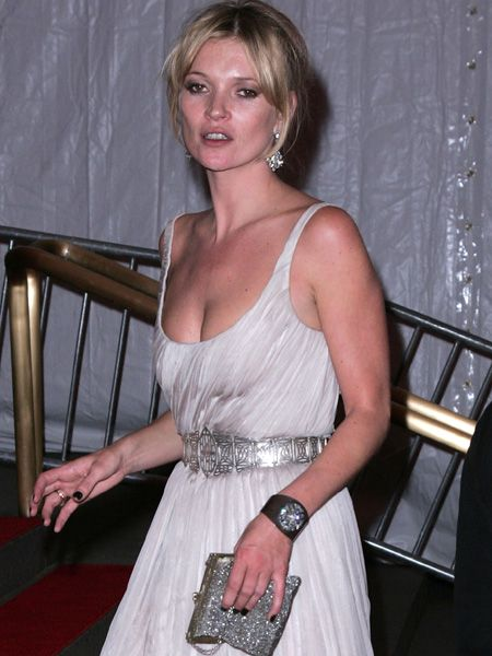 <p>The model accessorised her glam gown with a bold black time piece; confirming its place on the fashion barometer </p>