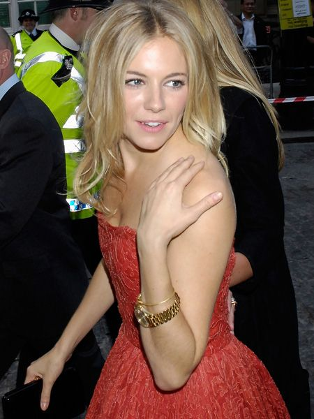 <p>The fashionista went for gold at a recent premier, illustrating the influence a super-size watch can have on your outfit</p>