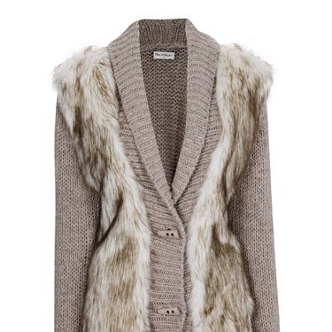 """<p>On those sunny winter days, there's nothing quite as stylish as bundling up in an oversized cardigan - and with a luxe faux fur front, this cosy number is as stylish as they come.</p><p>Cardigan, £50, <a href=""""http://www.missselfridge.com/"""">Miss Selfridge</a></p>"""